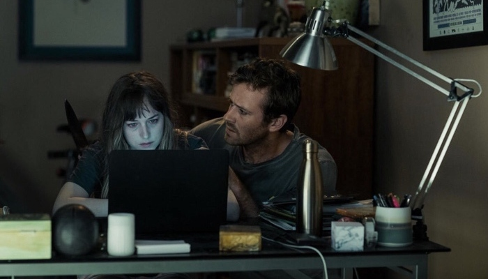 Will and Carrie behind the laptop in Wounds 2019