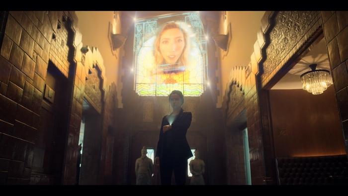 Kristin Ortega showing villain Rei on her ONI in Altered Carbon season 1