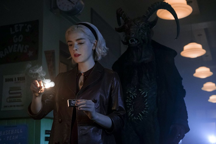 Sabrina Spellman strikes a match with The Dark Lord behind her in Chilling Adventures of Sabrina part 2