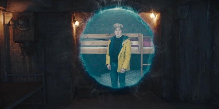 Jonas in bunker looking through time portal