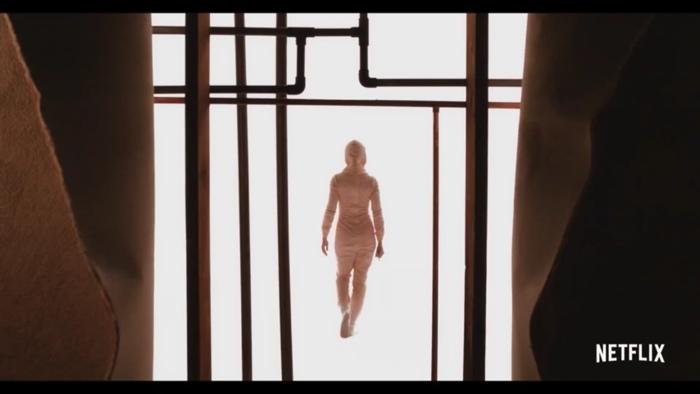 Sarah walking in a surreal dream in Horse Girl 2020