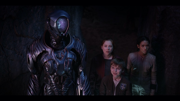 Robot, Will, Penny and Judy in the caves in Lost in Space season 1