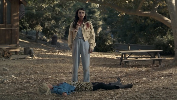 Brooke standing over the body of Montana in American Horror Story season 9 1984