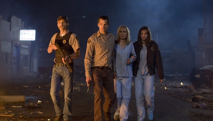 Russell, David, Judy and Becca walking through desolated streets in The Crazies 2010