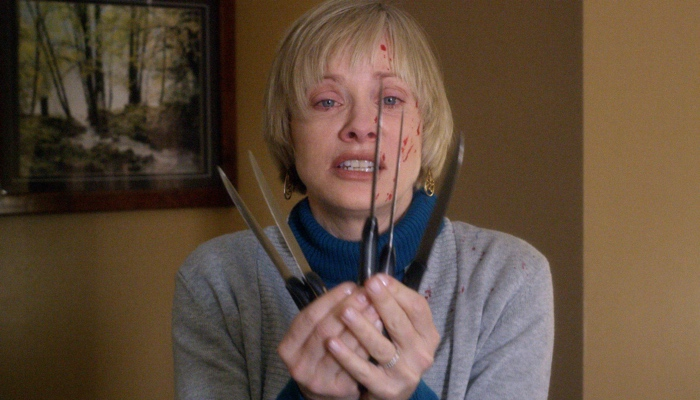 Anne holding knives in We Are Still Here 2015
