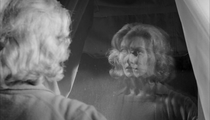 Mary Henry looking in distorting mirror in Carnival of Souls 1962