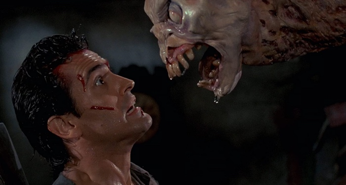 Ash attacked by a big demon in Evil Dead 1987