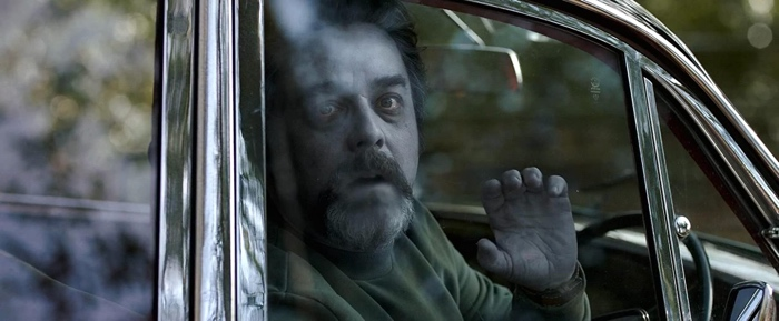 Philip Goodman scared in his car in Ghost Stories 2017