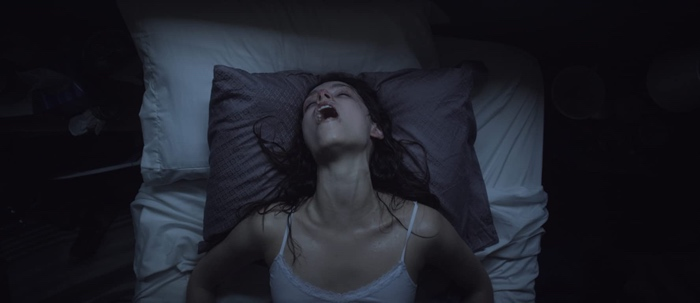 Sarah Walker in bed in Starry Eyes 2014