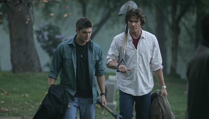 Sam and Dean in the graveyard with shovels in Supernatural season 2