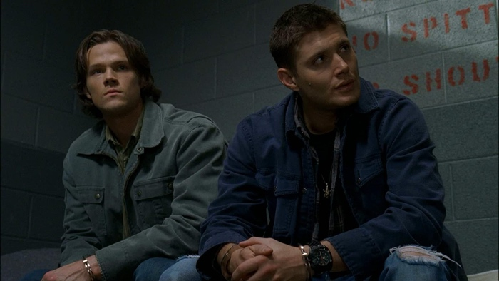 Sam and Dean Winchester in jail in Supernatural season 3