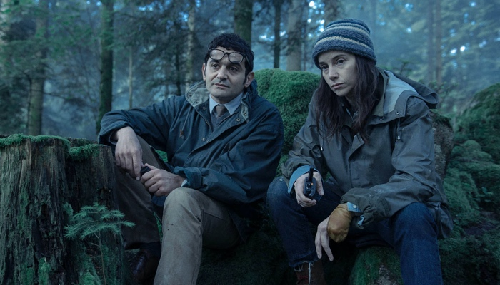 Frank Siriani and Laurene Weiss in the woods in Zone Blanche/Black Spot season 2