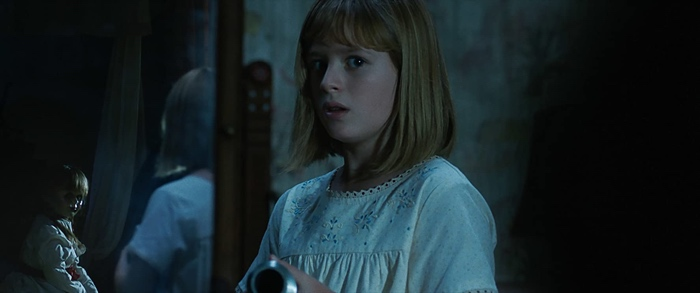 Linda is watched by the doll Annabelle in Annabelle Creation 2017
