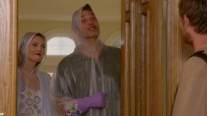 Sheila and Joel wearing plastic coats in Santa Clarita Diet season 1