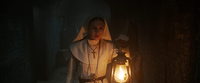 Sister Irene with a lantern in The Nun 2018