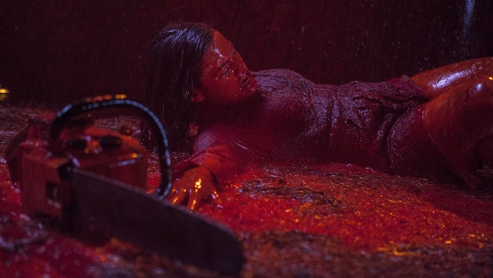 Mia reaching for the chainsaw in Evil Dead 2013