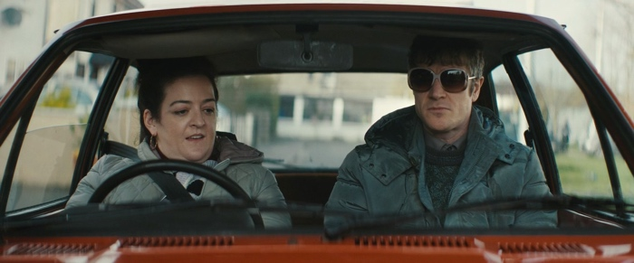 Rose and Martin sitting in Rose's car in Extra Ordinary 2019