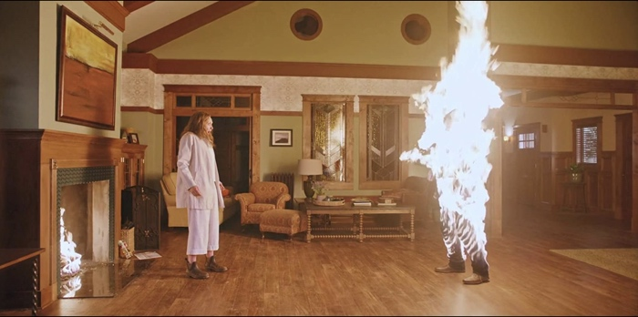 Annie sees Steve bursting into flames in Hereditary 2018