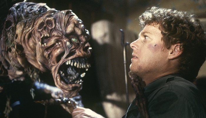 Roger attacked by the closet monster in House 1986