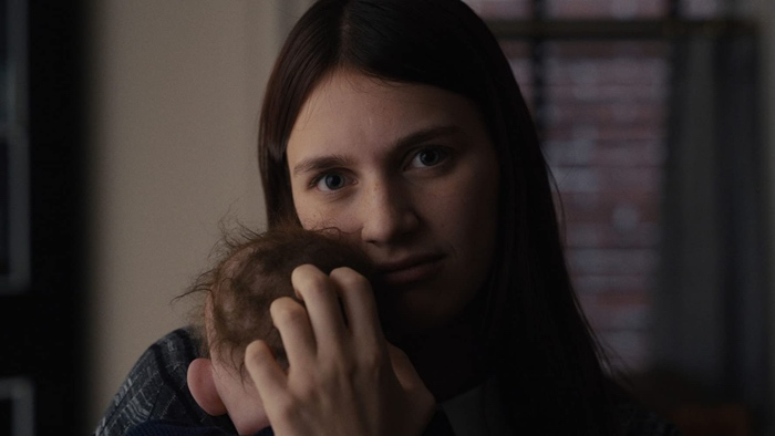 Leanne holding the doll baby in Servant season 1