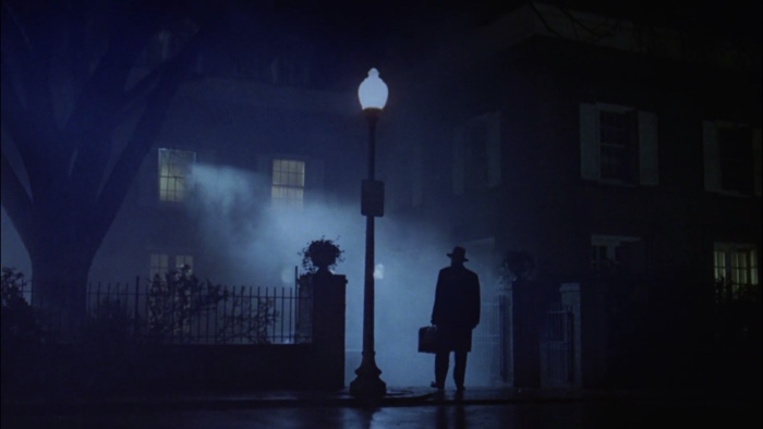 Father Lankaster Merrin standing in front of the house in The Exorcist 1973