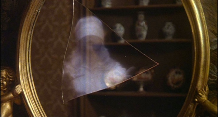Blindfoled Karen in the mirror in The Watcher in the Woods 1980