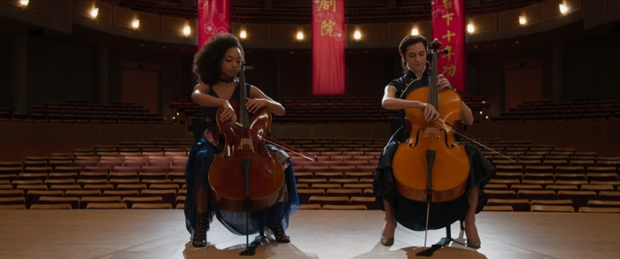 Charlotte and Lizzie playing the cello in The Perfection 2018