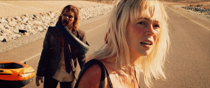 Molly has Smalls on a leash in It Stains the Sands Red 2016