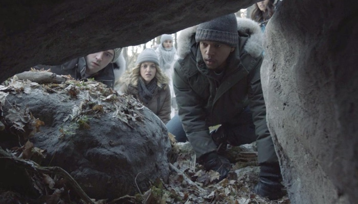 Peter, Dawn, Noah, Andi and Susan staring into an empty cave in Slasher season 3 Guilty Party