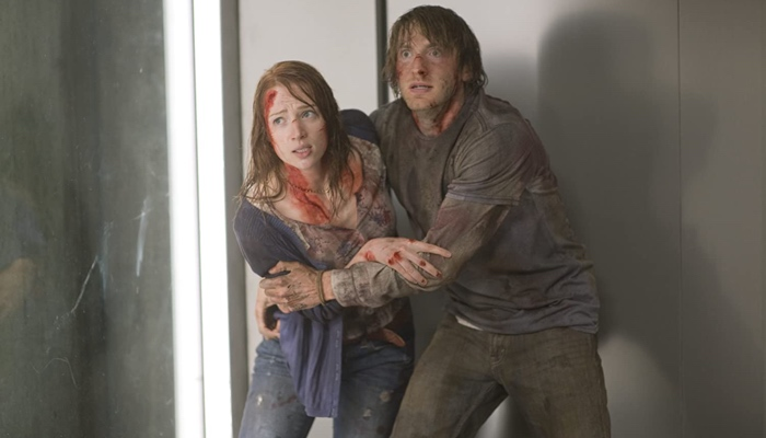 Dana and Marty scared and bloody in The Cabin in the Woods 2011