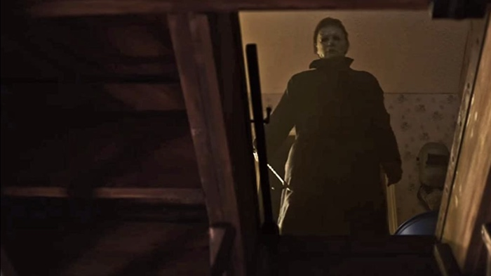 Michael Myers on top of the cellar steps in Halloween 2018