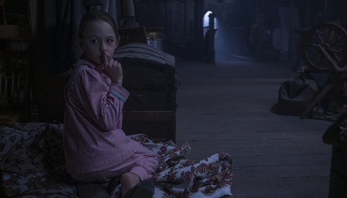 Flora in the attic in The Haunting of Bly Manor 2020