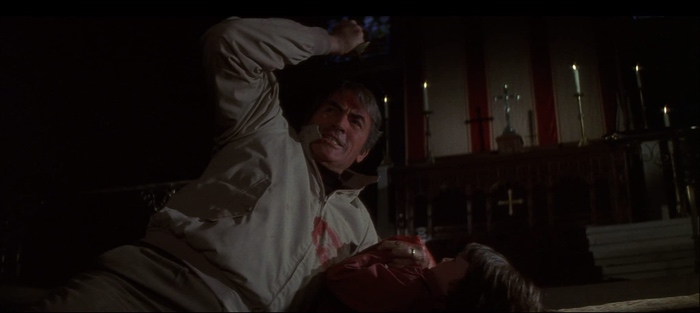 Robert trying to kill Damien in church in The Omen 1976