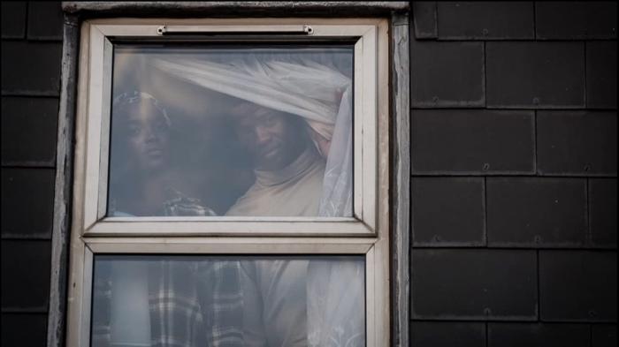 Bol and Rial behind the window in His House