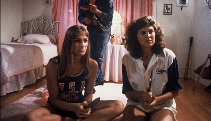 The killer sneaks up on Trish and Jackie in The Slumber Party Massacre 1982